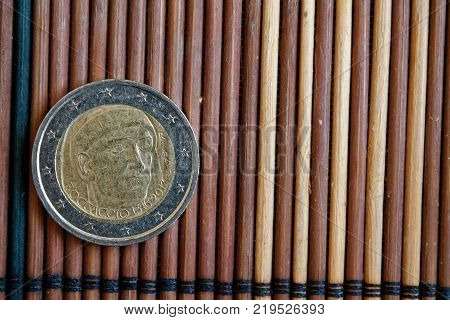 One Euro Coin Lie On Wooden Bamboo Table Denomination Is 1 Euro