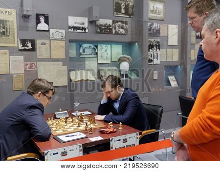 ST. PETERSBURG, RUSSIA - DECEMBER 4, 2017: Match Evgeny Tomashevsky (left) vs Vladimir Fedoseev during super finals of 70th Russian men's chess championship. Fedoseev won the match