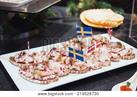 Trays with various delicious appetizer. Appetizer of fish.