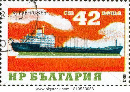 Ukraine - circa 2017: A postage stamp printed in Bulgaria shows drawing Cargo Ship Roschen. Series: Ships. Circa 1984.
