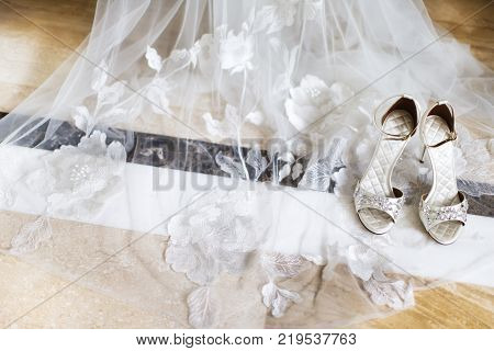 Wedding shoes with jewels on the bridal veil.