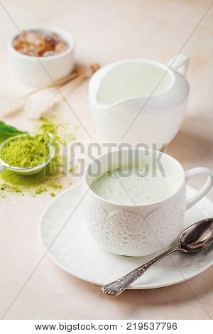 Green tea matcha latte cup on light background. Concept of a healthy diet, superfood, antioxidant, cleansing poster