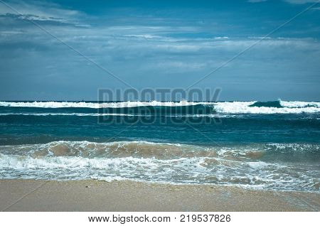 Indian ocean at Sri-Lanka. Picturesque frothy backwash from the Indian Ocean waves