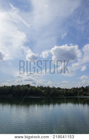 Lake in Woods. Pure lake in the forest. Beautiful sky