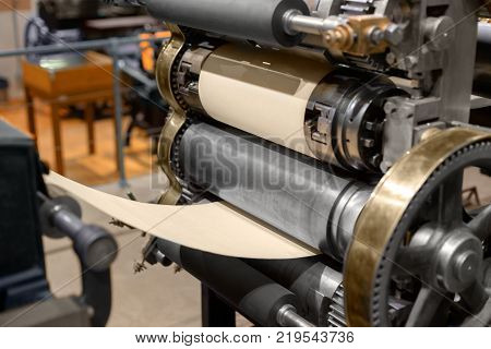 Old fashioned Press printing machine closeup indoors