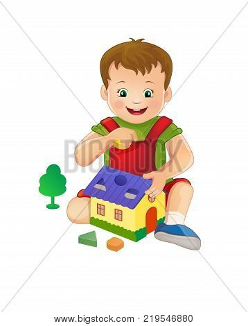 a little boy plays with toys, collects pyramid round puzzle. House. Round Windows.