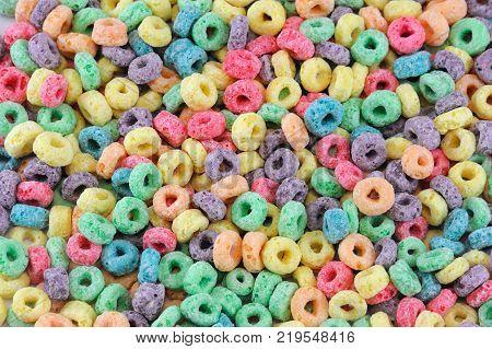 Colorful cereal loop rings, breakfast food background