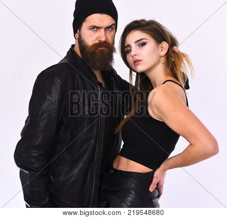 Girl And Bearded Man Sitting In Black Leather Jacket