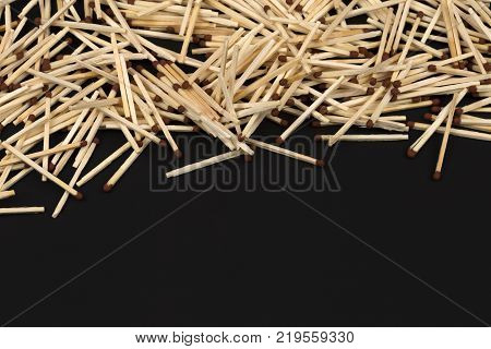 Matches on isolation copy space. A handful of matches on dark background. Flammable wooden sticks with place for text.