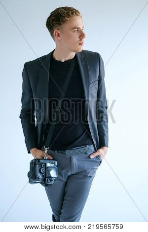 photography art camera equipment creative photographer lifestyle. Working process. Self-confident man fashion look.