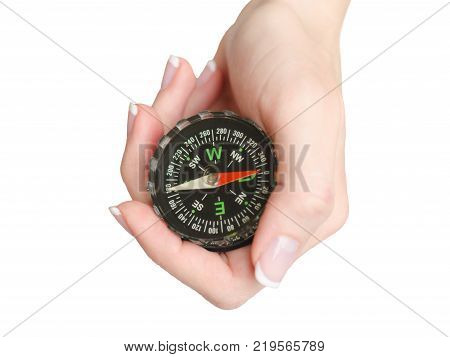 Hand of a young woman holds a compass isolated on white background