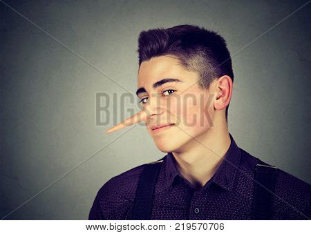 Liar funny looking young man with long nose