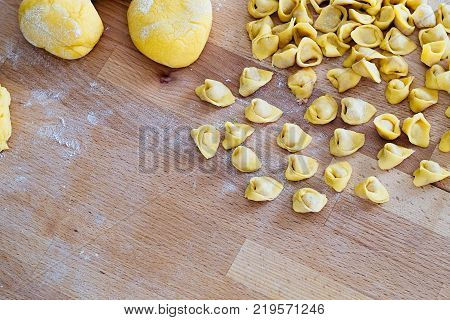 Tortellini typical pasta of Bologna Italy filled with meat and spices which is cooked with broth during the Christmas holidays