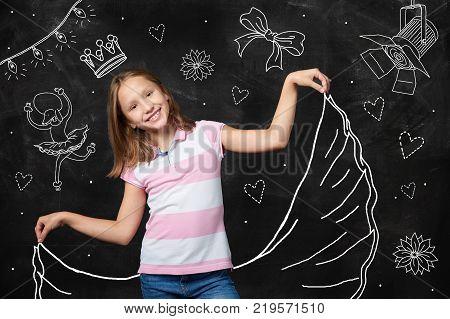 Little girl fantasy being a star, chalk board illustration on background