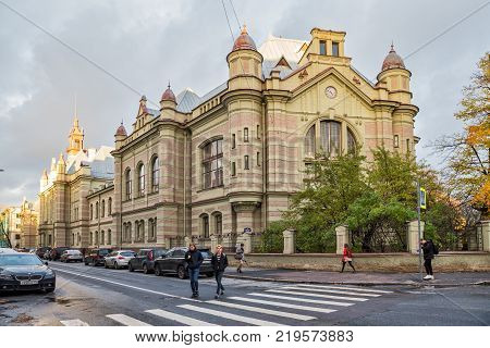 SAINT-PETERSBURG RUSSIA - OCTOBER 18 2017: The first the oldest building St. Petersburg State Electrotechnical University LETI on the street of Professor Popov. People on the street in the background of a historic building