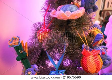 handmade toys adorn the New Year tree in room