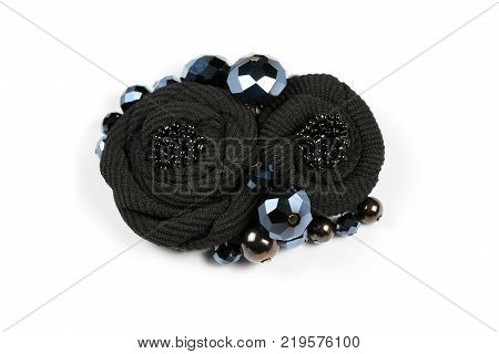 Brooch in the form of two black flowers from a fabric of handwork poster