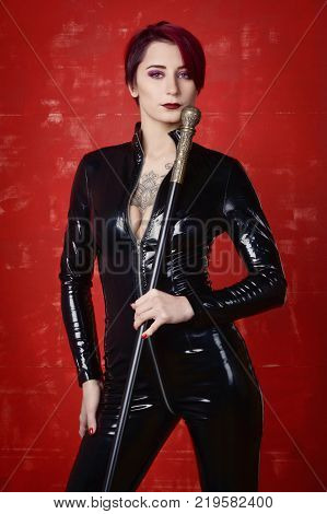 Beautiful fetish model in latex costume. BDSM concept poster