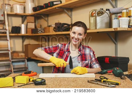 Beautiful Smiling Caucasian Young Brown-hair Woman In Plaid Shirt, Gray T-shirt, Yellow Gloves Worki