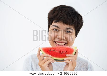 Excited young Asian woman eating healthy and tasty food. Joyful vivacious girl taking care of health. Joy concept