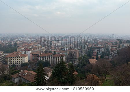 Aerial panoramic view on foggy Bergamo town in northern Italy