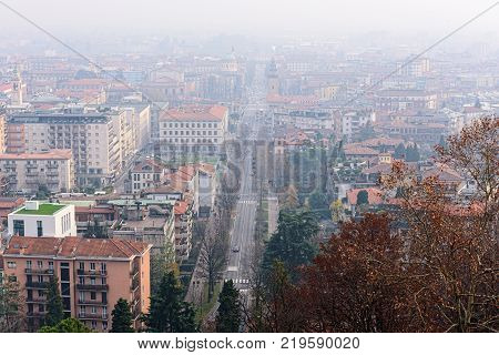 Aerial view on central street of foggy Bergamo town, Italy