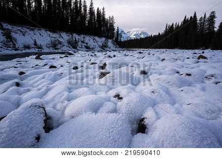 A snow covered river bed in the amazing Canadian Rocky Mountains on the way to Jasper National Park along the Icefields Parkway.