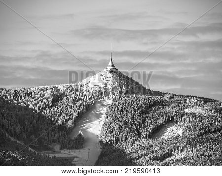 Morning sunrise at Jested Mountain and Jested Ski Resort. Winter time mood. Liberec, Czech Republic. Black and white image.