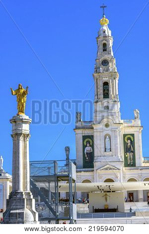 FATIMA, PORTUGAL  - SEPTEMBER 17, 2017 Christ Statue 100th Celebration Mary's Appearance Basilica of Lady of Rosary Bell Tower Fatima Portugal. Church created on site where three Portuguese Shepherd children saw Virgin Mary of the Rosary. Basilica created