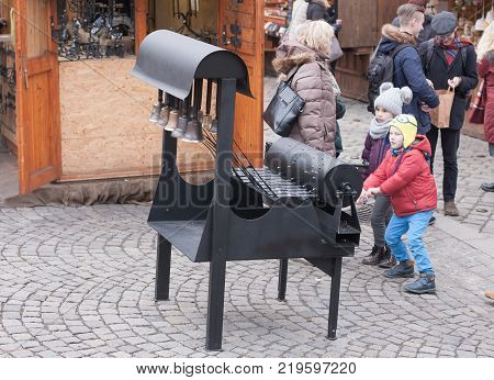 Brno,Czech Republic-December 18,2017: Children are playing bell chime at Christmas market on the Cabbage Market on December 18,2017 Brno Czech Republic