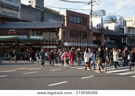 Kyoto Japan - November 27 2017: Pedestrians cross the street using the Zebra crossing at Gion area in Kyoto Japan.