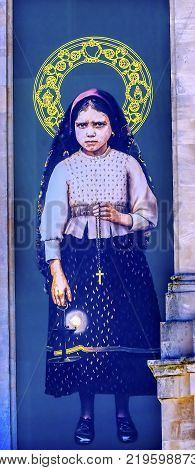 FATIMA, PORTUGAL - SEPTEMBER 17, 2017 Jacinta Banner 100th Celebration Mary's Appearance Basilica of Lady of Rosary Bell Tower Fatima Portugal. Site where Jacinta and two Portuguese Shepherd children saw Virgin Mary.