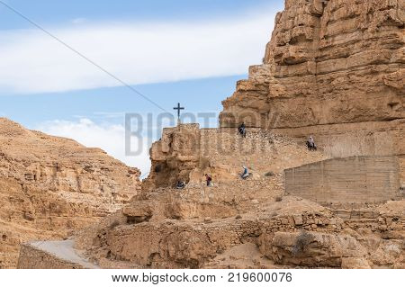 Near Mitzpe Yeriho Israel November 25 2017 : The frontier cross belonging to the monastery of St. George Hosevit (Mar Jaris) stands on the road leading to the monastery near Mitzpe Yeriho in Israel
