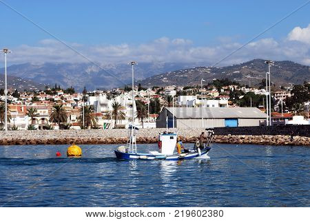 CALETA DE VELEZ, SPAIN - OCTOBER 27, 2008  -  Traditional fishing boat entering the harbour Caleta de Velez Malaga Province Andalusia Spain Western Europe, October 27, 2008.