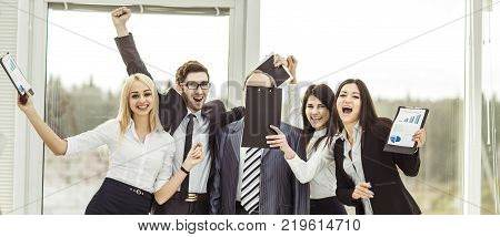 leader and successful business team cheering after signing a lucrative financial contract.