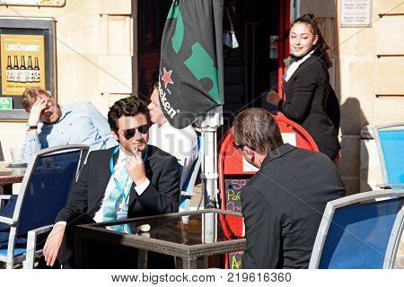 MOSTA, MALTA - APRIL 2, 2017 - Businessmen relaxing at a pavement cafe in the town centre Mosta Malta Europe, April 2, 2017.