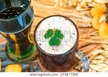 Mug of light beer and green Irish beer close-up in Patrick's Day