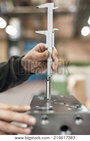 Repairer Using Accurate Ruler For Measuring In Workshop