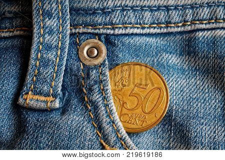 Denmark coin denomination is two krone (crown) in the pocket of obsolete blue denim jeans poster