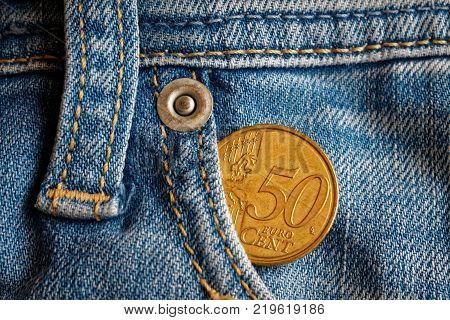 Denmark Coin Denomination Is 2 Krone (crown) In The Pocket Of Obsolete Blue Denim Jeans