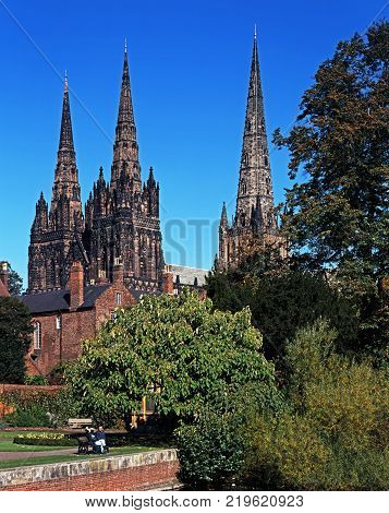 LICHFIELD, UNITED KINGDOM - JULY 20, 1994 - Cathedral Church of the Blessed Virgin Mary and St Chad with gardens of remembrance in the foreground Lichfield Staffordshire England UK Western Europe, July 20, 1994.