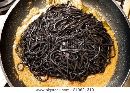 black pasta squid ink pan up view italian taglierini al nero di seppia.