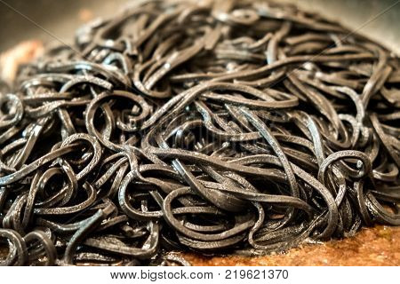 black pasta squid ink closeup italian taglierini al nero di seppia.