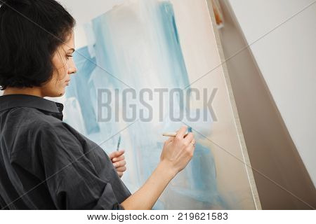 Woman in concept of arts therapy mental health profession uses creative process of art making to improve and enhance physical, mental and emotional well-being