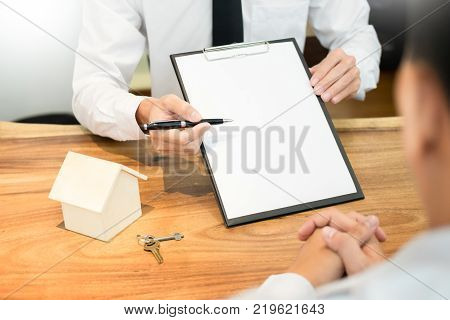 customer signing contract agreed terms and approved application and analyzing valuation home loan meeting with bank worker or real estate agent poster