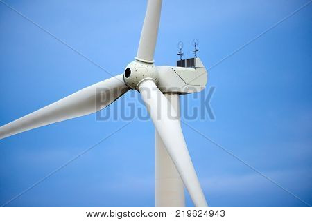 Wind power stations. Wind power is the use of air flow through wind turbines to mechanically power generators for electric power. A wind farm is a group of wind turbines in the same location used for production of electric power.