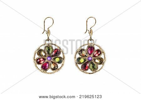 Pair of colorful gems flower shaped golden earrings on white background
