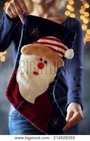 Girl holds a Christmas sock gift. Christmas concept