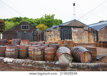 Whisky barrels full of whiskey in Scottish traditional distillery Dalmore. Wooden casks of whisky stocked outside. Dalmore, Scotland's oldest smallest producers of single malt whisky.Scotland, UK