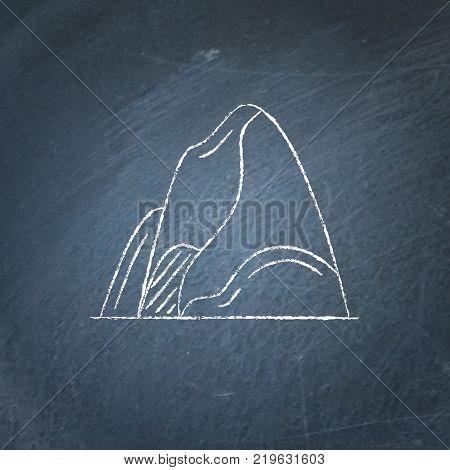Mountain icon on chalkboard. Outline rock symbol - chalk drawing on blackboard.